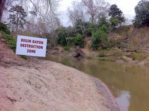 Sign erected by Save Buffalo Bayou announcing the beginning of the bayou destruction zone during the annual Buffalo Bayou Regatta.