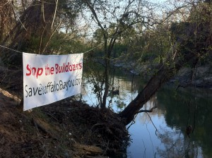 Save Buffalo Bayou banner disiplayed by a property owner on the north bank of the bayou in the project area during the annual Buffalo Bayou Regatta Saturday, March 7, 2015.