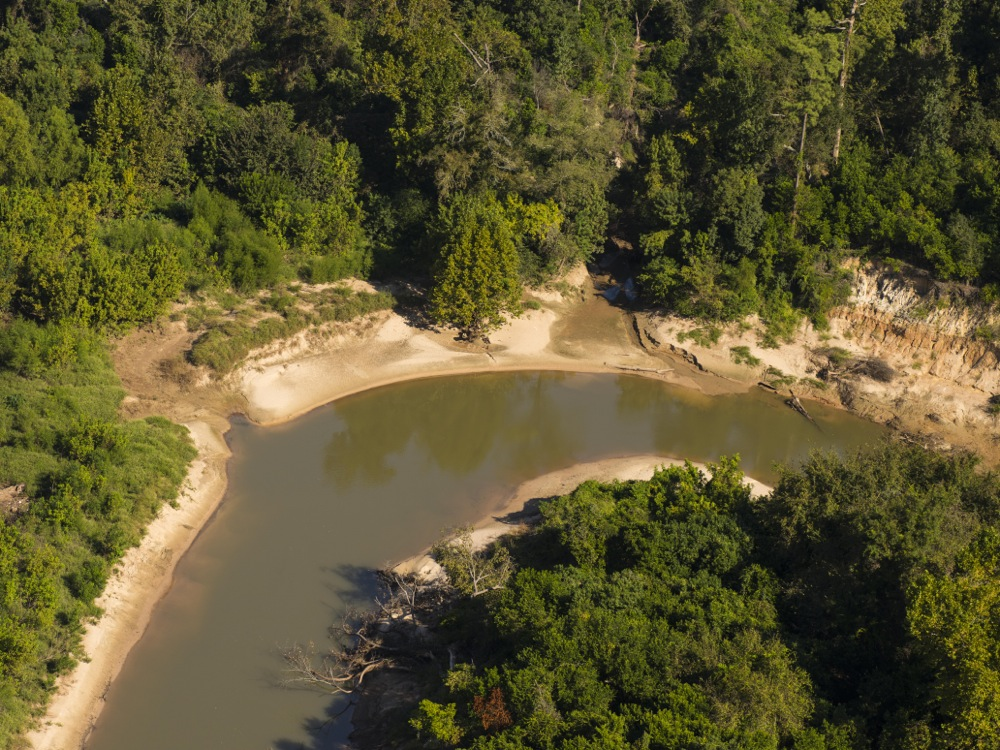 This beautiful meander, a natural detention area, would be filled in and graded, the woods and high cliffs destroyed, and the entire floodplain area obliterated by a permanent road. Aerial photo on Oct. 3, 2015, by Jim Olive