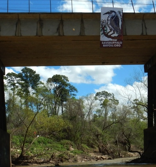 Save Buffalo Bayou banner hanging from the railroad trestle crossing Buffalo Bayou from Memorial Park. Photo March 12, 2016, by Richard Hyde.