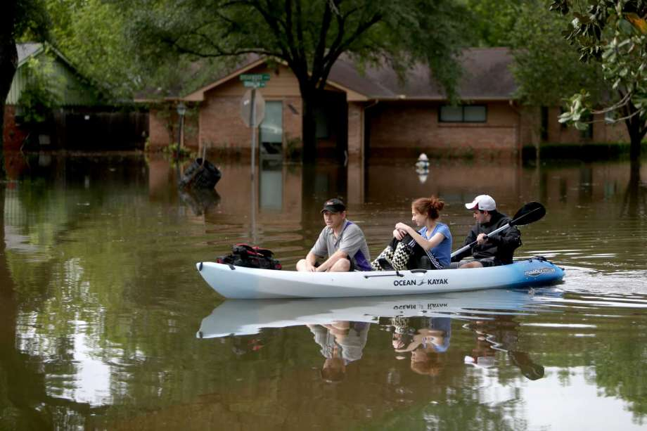 Gideon Miller Natanya Abramson And Yari Garner Canoe Along The 9300 Block Of Greenwillow In Flooded Willow Meadows Neighborhood On Monday April 18