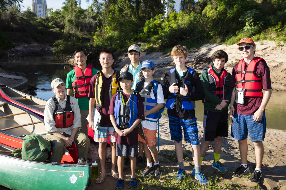 From left to right: Janice Walden, Richard Hung, and Troop 55 Boy Scouts Paul Hung, Andrew Hung, Nicolas Dinius, Chance Coleman, Jackson Douglas, Kendall Barnes, and Joseph Hlavinka at the Woodway Boat Launch in Memorial Park. Photo by Jim Olive on April 2, 2016