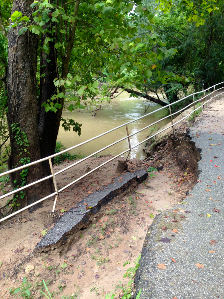 Damage to asphalt hike-and-bike trail built at edge of Buffalo Bayou in Terry Hershey Park. Commissioner Radack says trail will be put back where it was. Photo Aug. 16, 2016